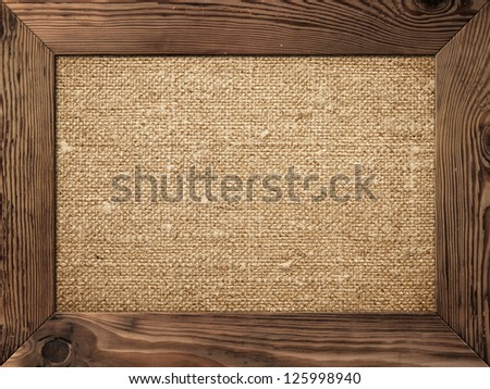 old wooden frame with cotton canvas inside
