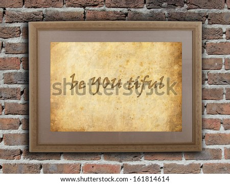 Old wooden frame with written text on an old wall - Be YOU tiful - stock photo