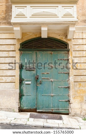 old wooden front door to the house in the Mediterranean