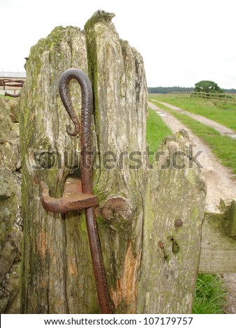 Old wooden gate post with metal catch
