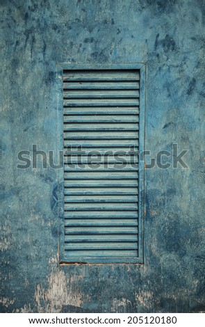 Old wooden gate with faded paint texture background - stock photo