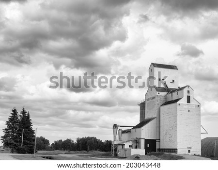 Old wooden grain elevator in black and white - stock photo