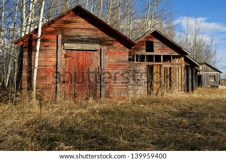 old wooden granaries in spring - stock photo