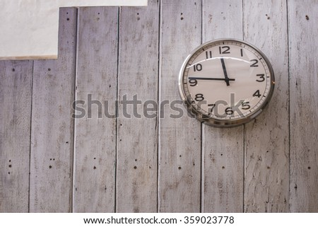 Old wooden grandfather clock hanging on a wall.
