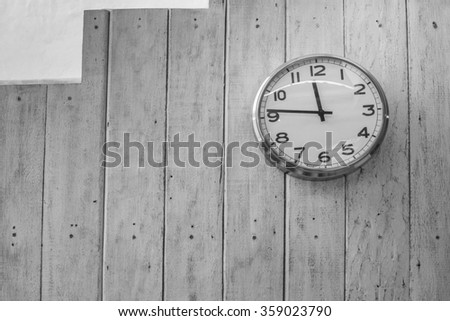 Old wooden grandfather clock hanging on a wall. - stock photo