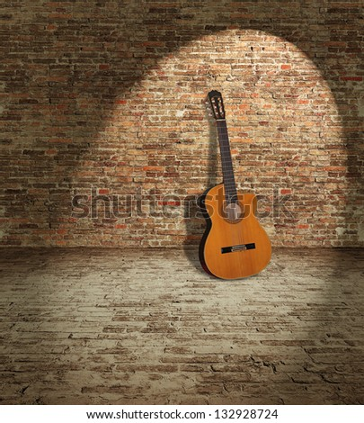 Old wooden guitar leaning against the brick wall