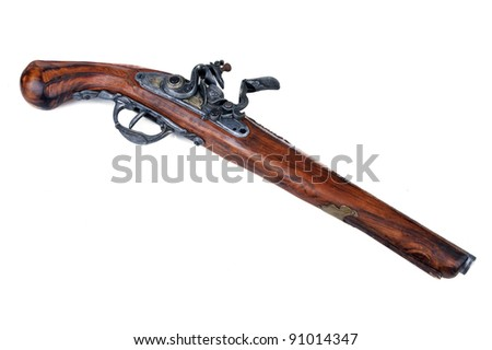 Old wooden gun isolated on white