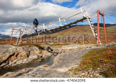 old wooden Hiking Bridge in Norway