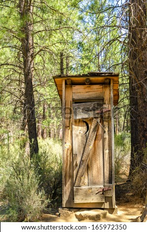 Old wooden historic outhouse in Bend, Oregon - stock photo