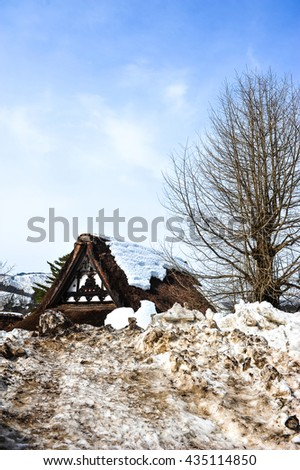 Old wooden house and dirty snow in Shirakawa Go village