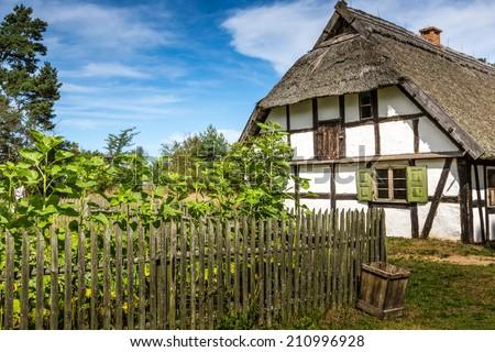 Old wooden house in Kluki, Poland - stock photo