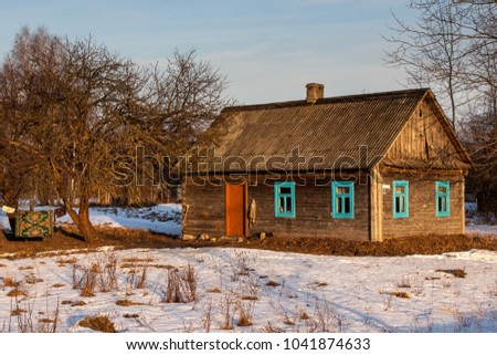 Old wooden house in russian village in winter with snow. Version 2.
