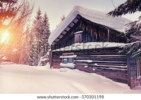 old wooden house in winter landscape photo - stock photo