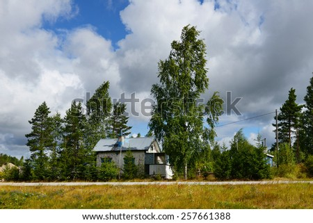 Old wooden house near road. Finland - stock photo