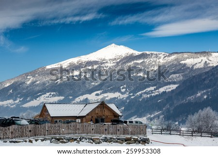 Old wooden house on snowy high mountain in Austrian Alps - stock photo