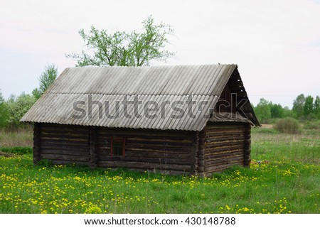 old wooden house stands alone in the abandoned village people - stock photo