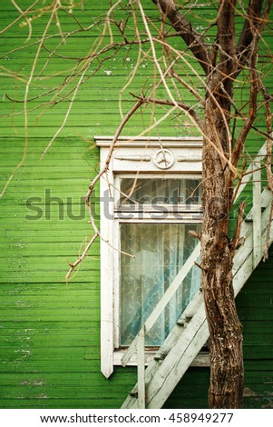 Old wooden house with green wall and window