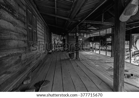 Old wooden house with Thai style in black and white tone