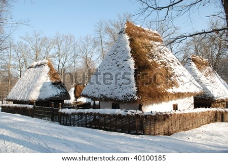 old wooden houses in snow