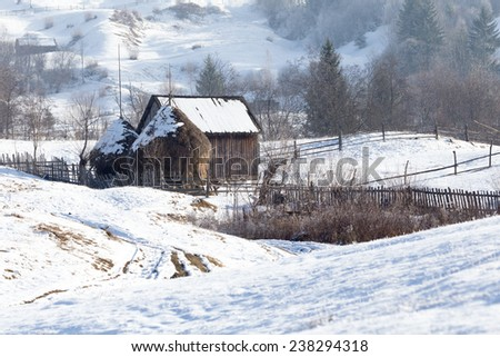 old wooden houses in winter time and snow landscape