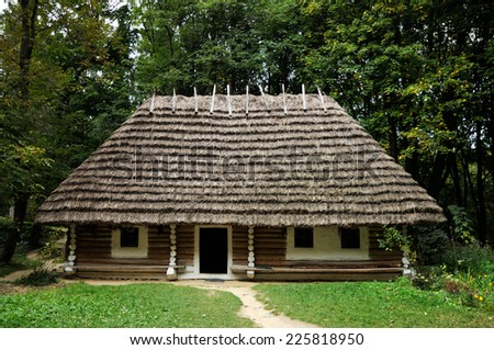 Old wooden hut covered with straw