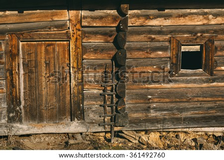 old wooden hut, the entrance to the house, window, door, texture - stock photo