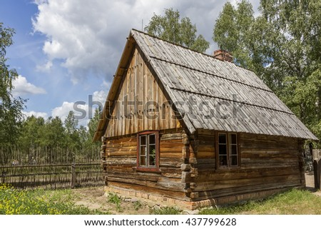 Old wooden hut with a fence - stock photo