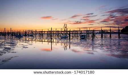 Old wooden jetty at Sandbanks in Poole Harbour in Dorset - stock photo