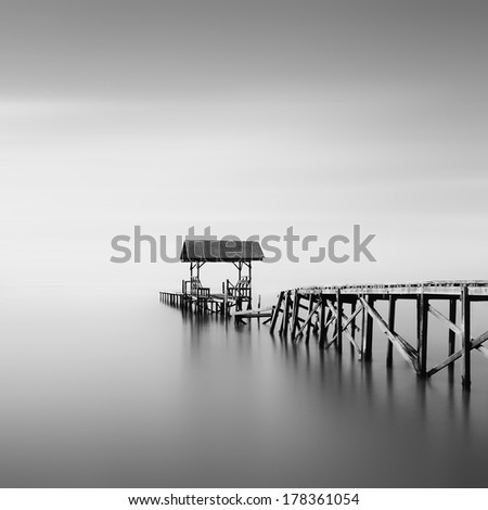 Old Wooden Jetty on Black And White - stock photo