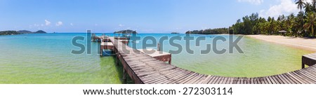 Old wooden jetty on exotic beach Koh Chang island, panorama - stock photo
