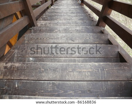 Old wooden ladder in village house - stock photo