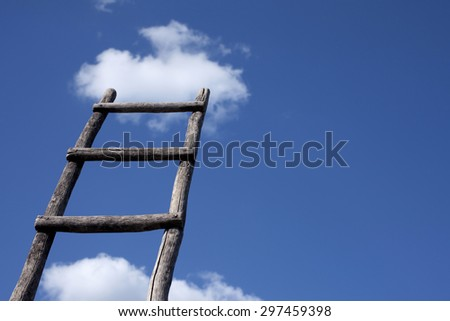 Old wooden ladder leading to a cloud in blue sky - stock photo