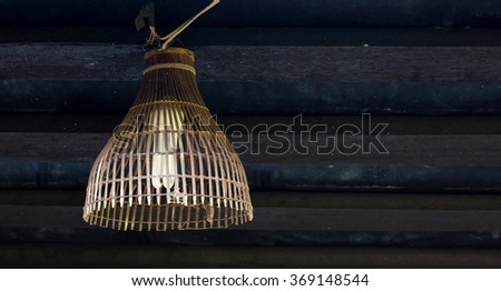 Old wooden lamp - stock photo