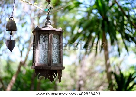 Old wooden lantern in forest.