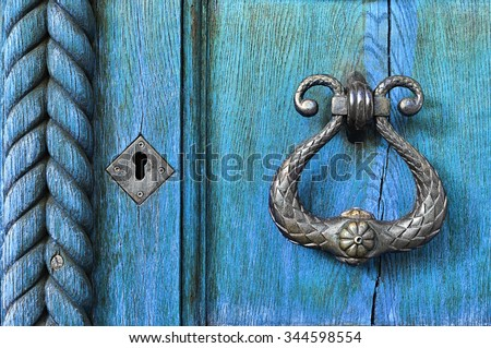 Old wooden light blue door  with aged metal door handle. Architectural textured background  - stock photo