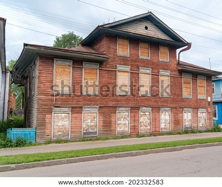 Old wooden mansion with fully nailed windows. Velikiy Ustyug, Russia.