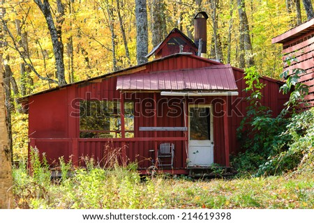 Old wooden maple syrup shed - stock photo