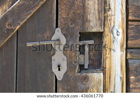 Old wooden outhouse door lock details