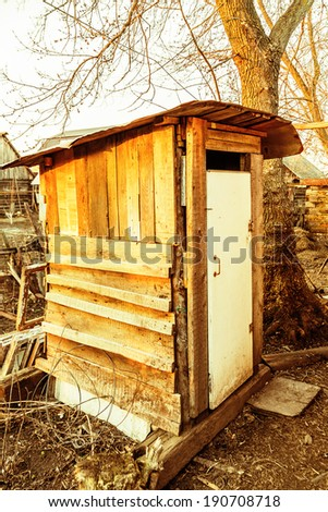 Old wooden outhouse in the russian countryside - stock photo