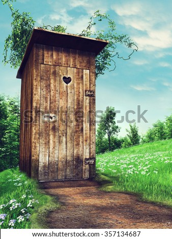 Old wooden outhouse on a meadow near a forest