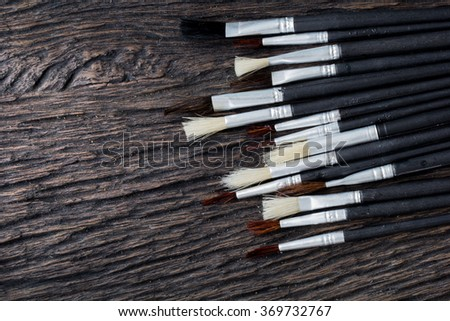 old wooden paint brushes