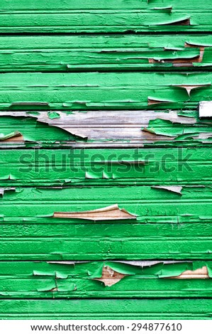 Old wooden painted bright green textured background with peeling paint  - stock photo