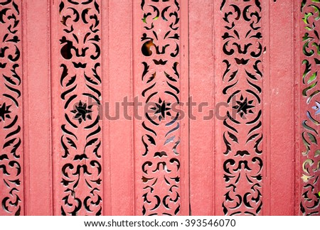 Old wooden painted pink vintage background with carved elements and cracked paint. Part of the outdoors decoration at Jim Thompson House, Bangkok, Thailand.  - stock photo