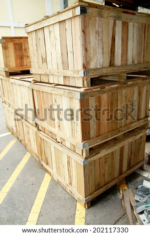 Old wooden pallet bunch in warehouse - stock photo