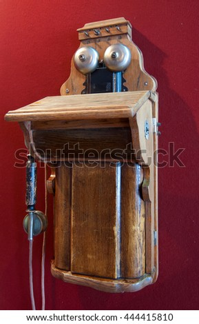 Old wooden phone hanging on the wall