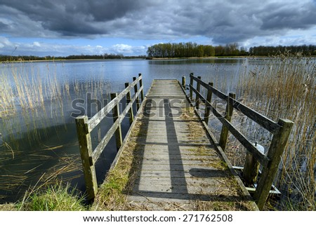 Old, wooden, pier with railings - stock photo