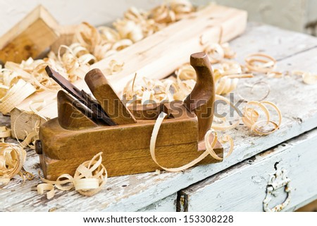 old wooden plane in a workshop of the carpenter - stock photo