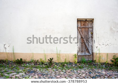Old wooden plank door of a abandoned house