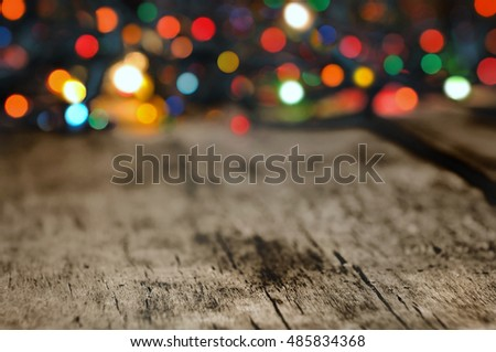 old wooden plank on a colorful lights background