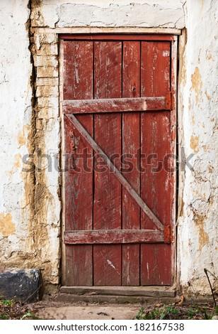 Old wooden plank vintage door - stock photo